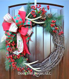 Front door wreaths~Christmas wreath~Holiday wreath~Wreath with antlers~rustic Christmas wreath~farmhouse wreath~country wreath by DoorandDecor on Etsy https://www.etsy.com/listing/252979464/front-door-wreathschristmas