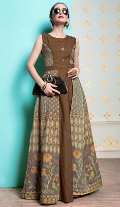 Add a small burst of colour inside your wardrobe with this Brown Color Heavy Michelin Abaya Style Designer Readymade Long Kurti. the ethnic print and handGowns - buy gowns for girls & womens online in india. Batik Fashion, Abaya Fashion, Muslim Fashion, Ethnic Fashion, Fashion Dresses, Model Dress Batik, Batik Dress, Dress Batik Kombinasi, Muslim Dress