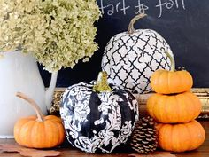 Give faux pumpkins, leftover from Halloween, a fashion-forward makeover by covering them with strips of trendy fabric. Large decoupage pumpkins are a stylish addition to front porch fall displays while small pumpkins will add a graphic pop to your Thanksgiving centerpiece.