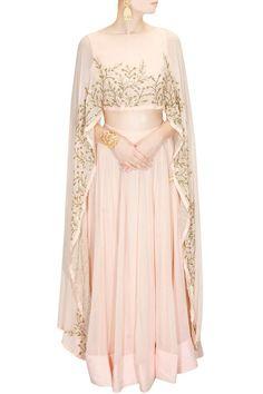 Buy Blush pink embroidered cape lehenga set By Prathyusha Garimella online in India at best price.Prathyusha Garimella presents Blush pink embroidered cape lehenga set available only at Pernia's Pop Muslim Fashion, Modest Fashion, Hijab Fashion, Indian Fashion, Fashion Dresses, Indian Dresses, Indian Outfits, Cape Dress, Dress Up