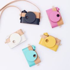 The Twig Co. wooden toy cameras in many colors.