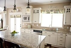 beautiful-white-kitchen-design-with-light-brown-wall