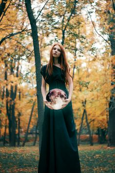 She walked through the forest, half in a trance, as the trees deepened and thickened. The orb in her hands was glowing softly, and she could almost feel a tingly warm wind brushing against her fingertips, even though she knew she shouldn't be able to feel it.