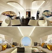 Luxury boat interior in cream upholstery and yellow and taupe cushions.   Raeline Upholstery can help achieve this look for your boat - contact us at www.raelineupholstery.com.au