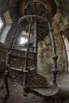 "Beautiful spiral staircase. ""Abandoned palace in Poland. What is it about abandoned things that they just sit, unseen by the passing public, and they just get dusty and old, and no one seems to see them anymore? Why is that the case? And why are they so much more beautiful than everything we build now? If only we would repair them..."""
