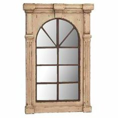 """Bring a touch of vintage-inspired style to your living room or foyer with this lovely wood-framed wall mirror, featuring a window-inspired silhouette and fluted column accents. Product: Wall mirrorConstruction Material: Wood and mirrored glassColor: Natural frameFeatures:Window-inspired silhouetteFluted column accentsDimensions: 48"""" H x 33"""" W x 3"""" D"""