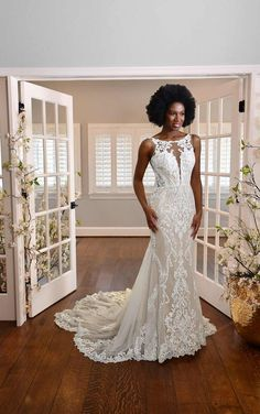 This quintessential gown takes classic bridal elements, from lovely lace to a full-length train, and elevates it for the modern bride. Stunning graphic lace placed over the entire bridal gown effortlessly contours the body to highlight and flatter the figure. The cascading train finishes this dress to give you the ultimate bridal moment while walking down the aisle. Essense of Australia   Style: D3153 Wedding Dress Necklace, Lace Wedding Dress, Designer Wedding Dresses, Essence Of Australia Wedding Dress, Bridal Gowns, Wedding Gowns, Bridal Elegance, Essense Of Australia, Bridal Boutique