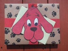 My wrapping job for my cousin's 1st birthday!  Clifford is drawn by hand on red construction paper and cut out!