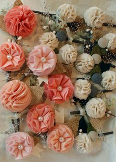 fabric corsages with burlap, buttons, fabrics, twigs