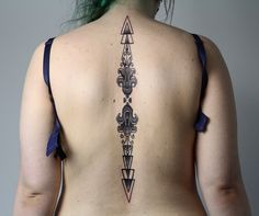 Pattern on spine tattoo