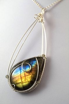 A delicate, unique, handmade, wire wrapped pendant with Labradorite.  Pendant was designed and made by Me, using an extremely labor-intensive and precise wire-wrapping technique, with silver 925, 930 and 999.  Dimensions of pendant: length: 8.8 cm (3.46 inch) width: 3.4 cm (1.33 inch)  You receive this unique pendant in jewelry box, so it is ready to be a gift.  ---On this auction You buy ONLY pendant without chain.----   Refunds and Exchanges:  If you are not satisfied with your purchase…
