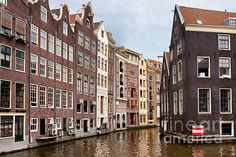 Amsterdam canal houses, traditional, historic, residential architecture in the capital city of the Netherlands.