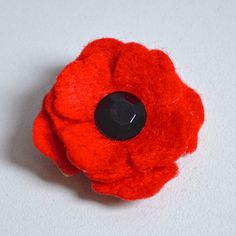 Small Red Poppy Lapel Pin Brooch with Glass Button Centre - Remembrance Armistice Day Poppy Appeal Charity Donation - Felt Flower Gift Boxed by MrWickstead on Etsy https://www.etsy.com/listing/209702562/small-red-poppy-lapel-pin-brooch-with