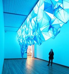 Like an overhanging iceberg, 'what lies beneath' is a glowing paper art installation by artist gabby o'connor.