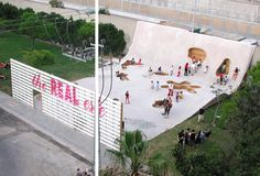 """Designed by AL/Arch, """"the REAL estate temporary private spaces"""" was designed to become an alternative public space at the edge of the freeway in Bat-Yam."""