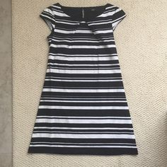 Black/White⚫️⚪️ Dress Very cute dress. Zip on the side. Used once! No trade! F&F Dresses