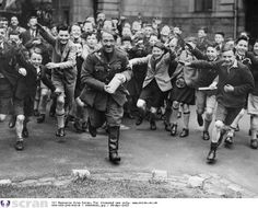School boys from Robert Gordon's College in Aberdeen chase a man dressed as Adolf Hitler.  1938