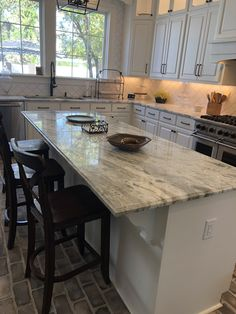 We found a slab of Fantasy Brown Granite for all of our countertops. We love all the white and greys and browns in the stone! Our island is a wonderful workspace! White Cabinets White Countertops, Brown Granite Countertops, Granite Kitchen, Kitchen Flooring, Kitchen Countertops, Concrete Countertops, Kitchen Redo, Home Decor Kitchen, New Kitchen