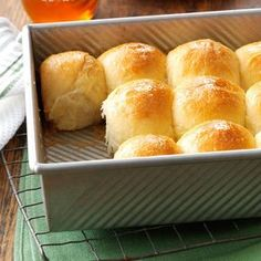Golden Honey Pan Rolls Recipe -A cousin in North Carolina gave me the recipe for these delicious honey-glazed rolls. Using my bread machine to make the dough saves me about 2 hours compared to the traditional method. The rich, buttery taste of these rolls is so popular with family and friends that I usually make two batches so I have enough! -Sara Wing, Philadelphia, Pennsylvania