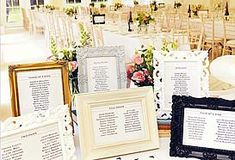 Fun, vintage frames painted in wedding colors to display seating info.