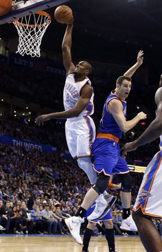 Oklahoma City's Serge Ibaka (9) dunks over New York's Jason Smith (14) during the NBA game between the Oklahoma City Thunder and the New York Knicks at the Chesapeake Energy Arena in Oklahoma City, Friday, Nov. 28, 2014. Photo by Sarah Phipps, The Oklahoman