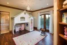 Traditional Kids Bedroom with Crown molding, Built-in bookshelf, Carpet, Pendant Light, Hardwood floors, High ceiling