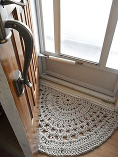 Crocheted half moon rug for in front of door or in bathroom.