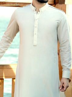 Designer Shalwar Kameez is the best garments of Pakistan for men and ladies. Not just in Pakistan, people in other Muslim countries also wear shalwar kameez on special days or occasions like Friday,. Gents Kurta Design, Boys Kurta Design, Kurta Pajama Men, Kurta Men, Mens Shalwar Kameez, Pathani Kurta, Pakistani Kurta, Kurta Style, Formal Shirts For Men