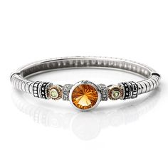 MSRP: $699.99   Our Price: $499.99   Savings: $200.00    Item Number: 141BG111262CTPDWT(4)    Availability: Usually Ships in 5 Business Days    PRODUCT DESCRIPTION:    A Vibrant Citrine sits center stage in this expertly crafted bangle bracelet for her. Crafted in fine sterling silver, this beautiful bangle features silver bead accents with 14k yellow gold rope accents that surround amethyst gemstones. This beautiful bangle would make a stunning addition to any jewelry collection…