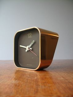 """A great estate sale find, this Smith Metal Arts """"Radius One"""" desk clock, designed by William Sklaroff, is still made, but not in solid brass via"""