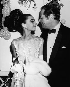 "Audrey Hepburn photographed with actor Rex Harrison at the premiere of their new film ""My Fair Lady"""