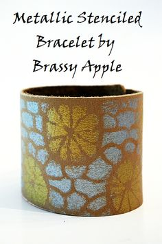 Crafting jewelry is one of my favorite types of crafts to create. Jewelry making is fun, and often time very simple. It doesn't take much to create a trendy and fashionable piece. I recently came across this craft project made by one of favorite craft blogs, Brassy Apple. Check out this awesome Metallic Stenciled Bracelet.