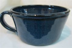 Cereal bowl with handle. Great for soup, cereal, ice cream, salad. Microwave, oven, and dishwasher safe. Made by Janet Calhoun of Traditions Pottery