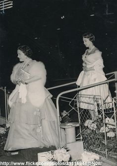 DATE:July 21 1955 D:Queen Mother and Princess Margaret leaving the Royal Box after watching the jumping at the White City Stadium /original photo Captain Peter Townsend, White City Stadium, Margaret Rose, Lady Elizabeth, Queen Mother, Princess Anne, George Vi, Royal House, Royal Jewels