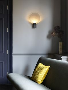 "With a handmade glass disc, the Nimbus wall lamp is marked by not only its simplicity, but by its notion of tranquility. A piece that would complete any room, the Nimbus is reminiscent of a halo. 10"" x 13"" Structure in bronze or satin brass Handmade glass disc Made in England Download spec"