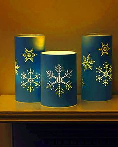 punched holiday lanterns, light up like tin can lanterns but made from paper.Tin Can Candles - Decorating with lights – 20 DIY String Light Projectssnowflakes patterns for can Beautiful Christmas Home Decoration Ideas From Martha Stewart Noel Christmas, All Things Christmas, Christmas Crafts, Christmas Decorations, Xmas, Christmas Lanterns, Candle Decorations, Snowflake Decorations, Nordic Christmas