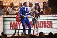 Pin for Later: Better Times: Amy Winehouse's 25 Most Memorable Moments  She joined Mark Ronson on stage at the Brit Awards in February 2008.
