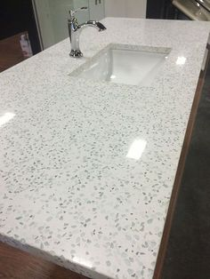 I am intrigued by recycled glass countertops. They are a bit cheaper than quartz. Curava in Action   Recycled Counters