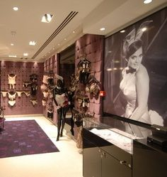 Playboy arrives in London with a three-story space designed to showcase the brand's fashion offering. On the second floor, the brand's White Label Lingerie gets a sophisticated setting complete with chandeliers, customized logo carpeting and a large-scale graphic of former Bunny Carol Imhot, who was featured in the magazine's March 1970 issue. View Image Details