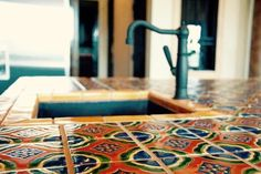 Colorful Mexican tile countertop to inspire your next kitchen remodel.