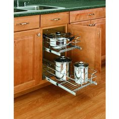 Rev-A-Shelf 2-Tier Metal Pull Out Cabinet Basket for the left of the sink and maybe next to fridge cabinets. Lowes $69.99 they have 1 & 2 tier. single is cheaper by a little bit.