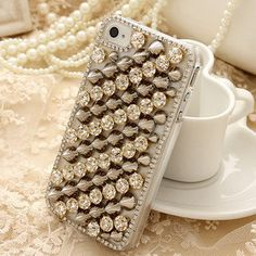 Glitter rhinestone bling bling case keeps your phone blinged out in an array of beautiful rhinestones. Visit https://www.etsy.com/shop/twinklecases for more information