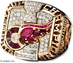 All Stanley Cup Championship winners receive two pieces of a replica cup, and a championship ring. Total Pro Sports thinks the Red Wings' 2002 championship ring design is the best of the best for its gemstone-encrusted team logo and diamond cup. Nba Championship Rings, Nba Championships, Stanley Cup Rings, Pro Hockey, Hockey Memes, Original Six, Evgeni Malkin, Kobe Bryant Pictures, Red Wings Hockey