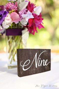 Instead of numbers I would put the table name on it. Rustic+Wooden+Table+Numbers++Rustic+Weddings+by+ThePaperWalrus,+$4.50