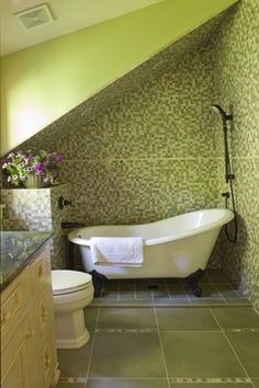 Claw foot tub and mosaic tile