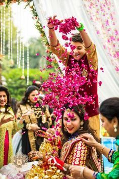 flower shower on Indian bride with her brother