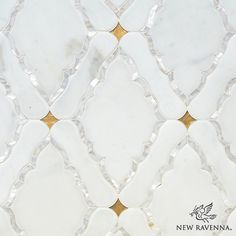 Josephine, a water jet mosaic shown in Shell, Venetian honed Calacatta and honed 24K Gold Glass, is part of the Aurora™ Collection by Sara Baldwin for New Ravenna.
