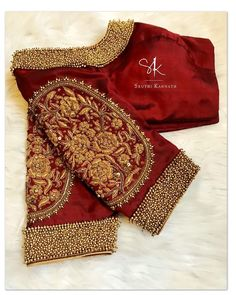 A design closer to heart. Stunning green color designer blouse with elephants and chaandbali design hand embroidery gold thread and bead work. Blouse Back Neck Designs, Netted Blouse Designs, Hand Work Blouse Design, Wedding Saree Blouse Designs, Pattu Saree Blouse Designs, Stylish Blouse Design, Fancy Blouse Designs, Designer Blouse Patterns, Fashion Styles