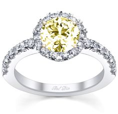 yellow canary engagement ring with micro pave halo.