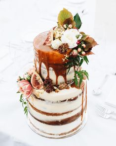Two tiered naked layer cake. Top tier: alternating layers of maple and salted caramel with honeycomb and fig. Bottom tier: alternating layers of orange blossom and rose with raspberry and rhubarb cake